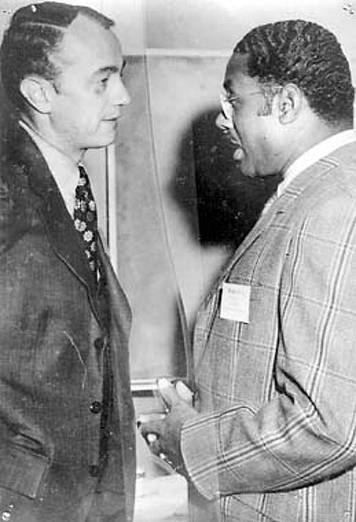 Robert Blackburn, former Oakland Deputy school superintendent, left, talks to the late Marcus Foster in 1972. Blackburn was wounded and Foster, the then school superintendent was killed by the SLA in 1973. photo courtesy of Robert Blackburn.