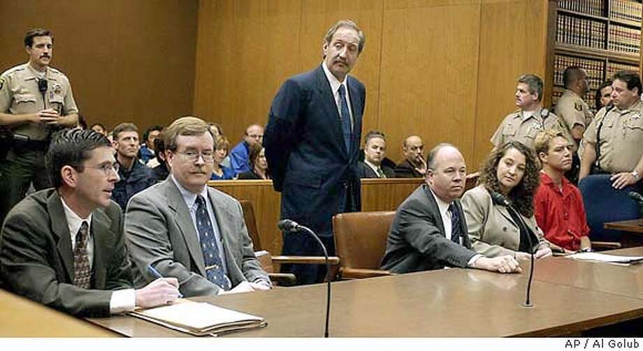 ** ADVANCE FOR USE MONDAY, MAY 31, 2004 - FILE ** Defense attorney Mark Geragos, standing center, listens as senior deputy district attorney Rick Distaso, left, speaks during a hearing for Scott Peterson, far right, in a Stanislaus County Superior courtroom May 2, 2003, in Modesto, Calif. Geragos, the mustachioed man in crisply pressed suits with a love for cigars and an easy swagger in his walk, is the man of the hour while Distaso is heading into the case of his career. Distaso is neatly groomed, nota hair out of place, a former Army attorney who attained the rank of captain. (AP Photo/Al Golub, Pool) ADVANCE FOR USE MONDAY, JUNE 1, 2004- FILE Photo: AL GOLUB