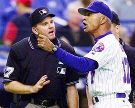 ** FILE ** Montreal Expos manager Felipe Alou argues with third base umpire Jim Reynolds during the fifth inning in Montreal Friday May 4, 2001. Felipe Alou was hired Wednesday, NOV. 13, 2002 to manage the National League champion San Francisco Giants, returning to the team he played for in the 1950s and '60s. The former manager of the Montreal Expos inherits a team that came within six outs of a World Series title and replaces the popular Dusty Baker, whose contract was not renewed.(AP Photo/Andre Forget)