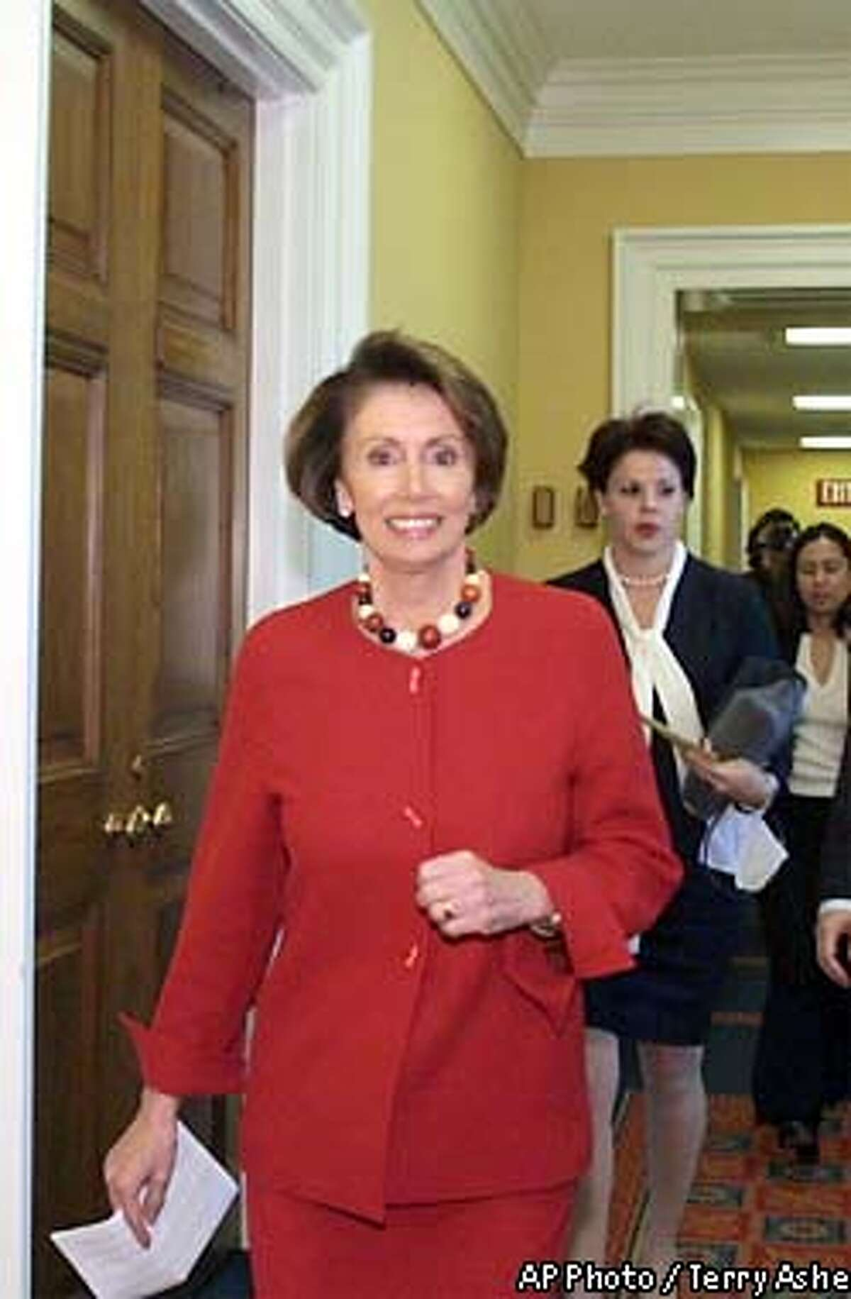 Rep. Nancy Pelosi, D-Calif., the current House minority whip and the favorite to become House minority leader, walks the halls on Capitol Hill Wednesday, Nov. 13, 2002. The election for Democratic top offices is scheduled for Thursday. (AP Photo/Terry Ashe)
