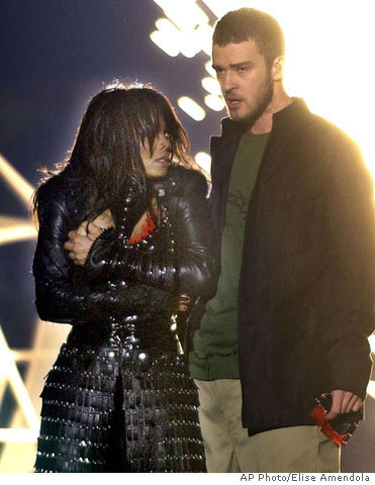 Singer Janet Jackson, left, covers her breast after her outfit came undone during a number with Justin Timberlake during the halftime show of Super Bowl XXXVIII in Houston, Sunday, Feb. 1, 2004. (AP Photo/Elise Amendola) ALSO RAN: 2/3/2004 Undone: Janet Jackson and Justin Timberlake are apologizing for what they insist was an accidental exposure of her breast during the halftime show.