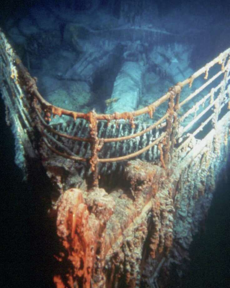 The bow of the Titanic looms from the ocean floor, two miles below the ocean's surface. / IMAX CORP./UNDERSEA IMAGING INTL