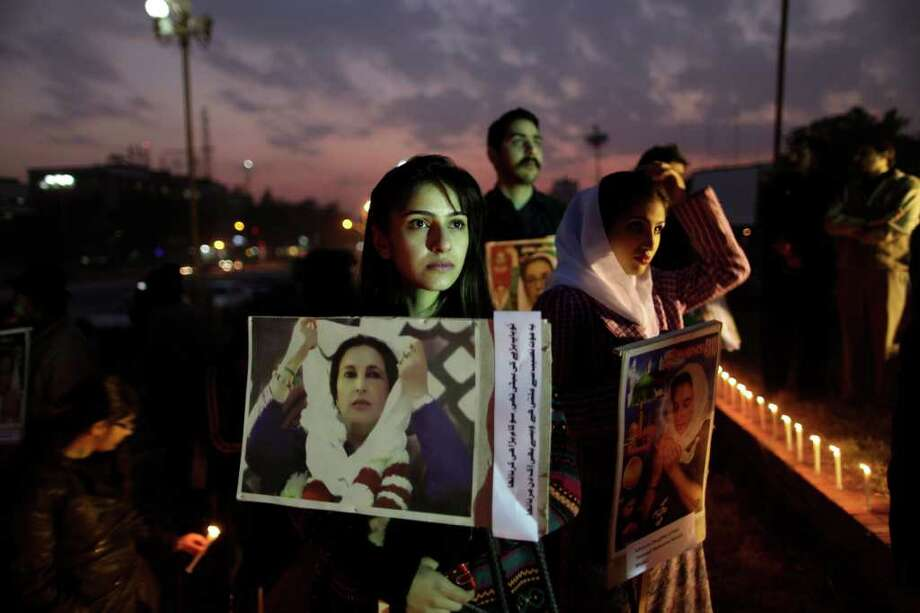 Supporters of Benazir Bhutto, Pakistan's slain leader, hold her posters at a ceremony to mark the fourth anniversary of her death last month, in Islamabad. Photo: Muhammed Muheisen / AP