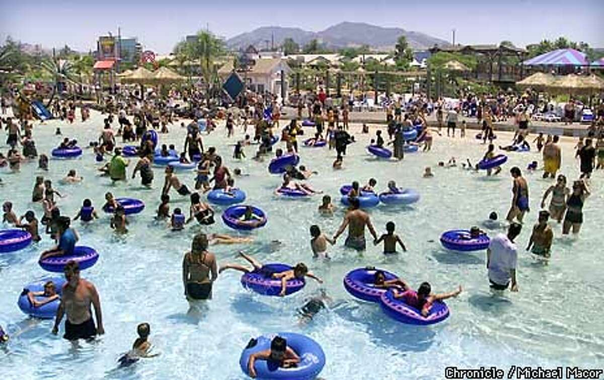 East Bay residents headed to the beach to cool off -- at least to the water beyond the artificial beach at Waterworld USA, where Mount Diablo rose in the background. Concord baked in heat that soared past 100 degrees. Chronicle photo by Michael Macor