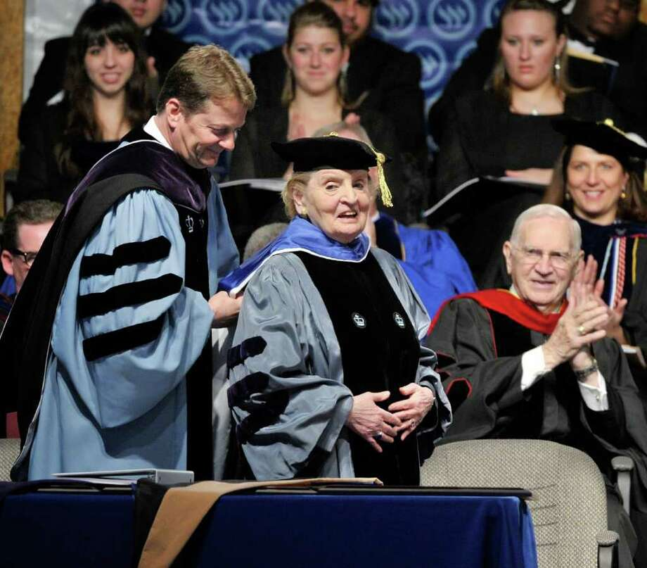 Former U.S. Secretary of State Madeleine K. Albright, right, receives a hood and honorary degree from TWU president Frederick G. Slabach, Friday, Jan. 27, 2012 at Texas Wesleylan University in Fort Worth, Texas.(AP Photo/The Fort Worth Star-Telegram, Max Faulkner)  MAGS OUT Photo: AP