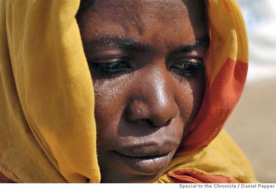 Iriba, Chad - March 16, 2004 - Asha Abdara Haman, 25, who was taken by the Arab Sudanese Janjaweed miltia and raped repeatedly. Photo: Daniel Pepper