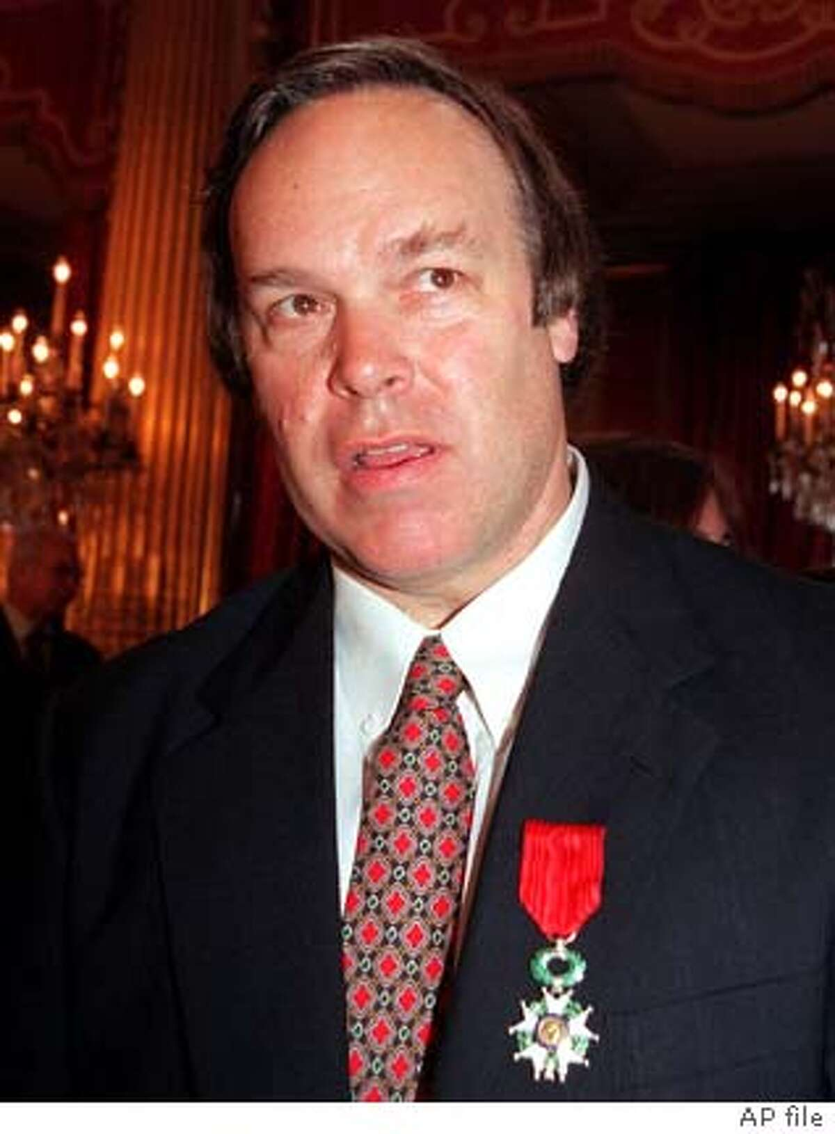 PARKER-C-08JAN03-FD-AP --- American wine critic Robert Parker after he was awarded Knight in the Legion of Honor by French President Jacques Chirac, Tuesday June 22, 1999 at the Elysee Palace in Paris. Parker, founder and editor of the bimonthly Wine Advocate newsletter, is also the author of several books on French wines.(AP PHOTO/Jacques Brinon) ALSO RAN 03/06/03
