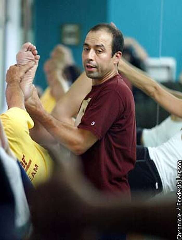 YOGA1-C-17OCT02-MT-FRL: Tony Sanchez, a respected SF yoga teacher has offer to teach Yoga for free to inner city schools. Once a Beverly Hills upper class way of centering yourself is now nation-wide household way to excerise. With more than 18 million yo? ga practitioners in the United States a number that's doubled since 1994 there's money to be made from meditation. Chronicle photo by Frederic Larson Photo: FREDERIC LARSON
