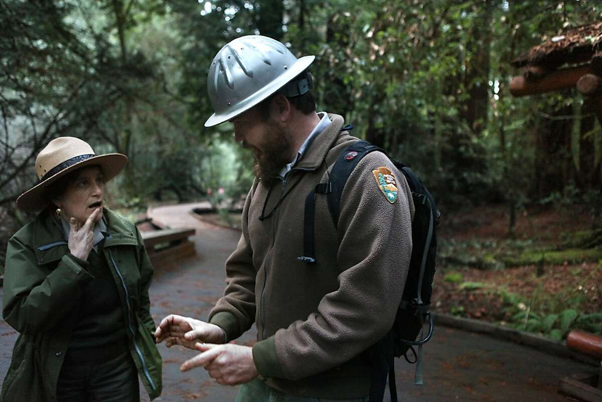 Ranger Mia Monroe (left) talking with trails program leader Barnaby Fisher about the recently constructed boardwalk (in background) at Muir Woods in Mill Valley, Calif., on Wednesday, January 25, 2012.