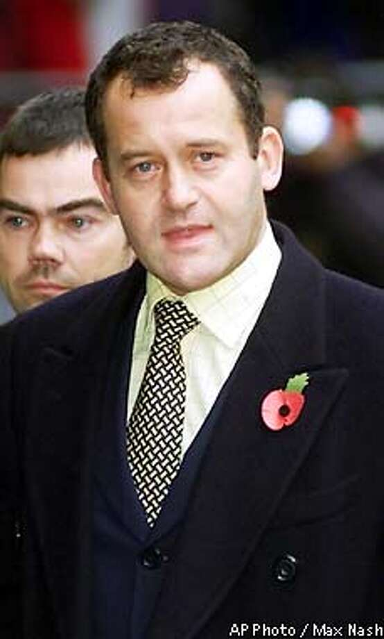 Paul Burrell, the former butler to the late Princess of Wales, arrives at the Central Criminal court, the Old Bailey, in London on Friday Nov. 1, 2002. Burrell denies the charges of theft of items belonging to the late Princess Diana. (AP Photo/Max Nash) Photo: MAX NASH