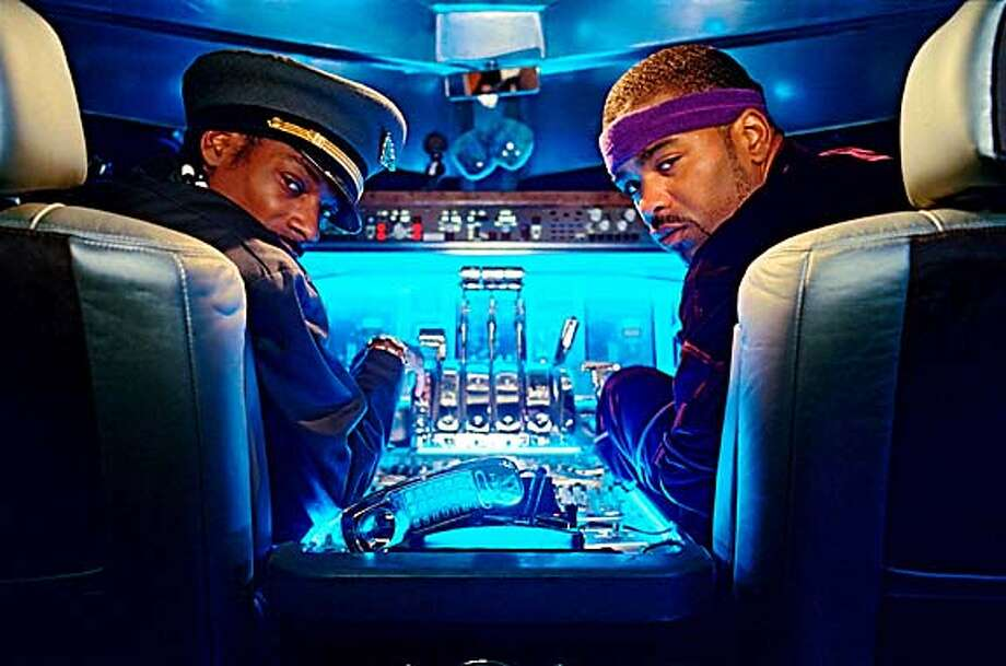 SNOOP DOGG and METHOD MAN star as Captain Mack and Muggsy in the cockpit of MGM Pictures� comedy SOUL PLANE. Photo by Bruce Talamon.