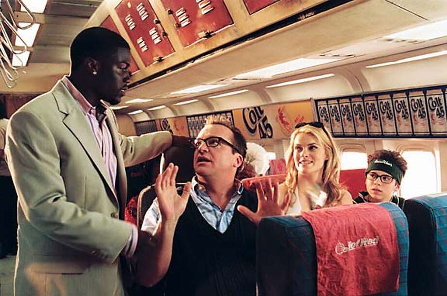 Airline owner Nashawn (KEVIN HART) with passengers Mr. Hunkee (TOM ARNOLD), Barbara (MISSI PYLE), and Billy Hunkee (RYAN PINKSTON) in MGM Pictures� comedy SOUL PLANE. Photo by Bruce Talamon.