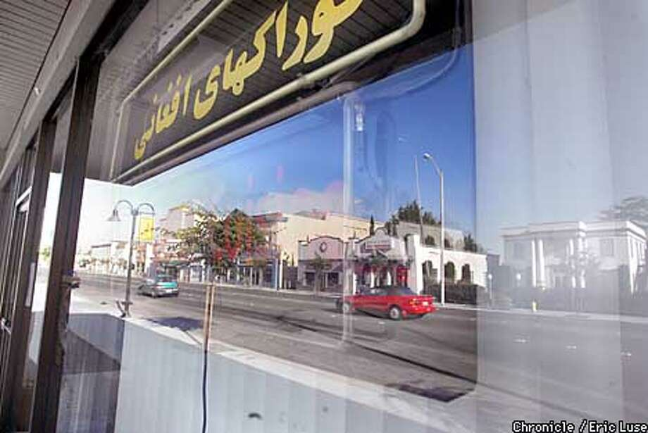The Salang Restaurant serving Afghan food is along Fremont Boulevard which is refelcted in the window.  BY ERIC LUSE/THE CHRONICLE Photo: ERIC LUSE