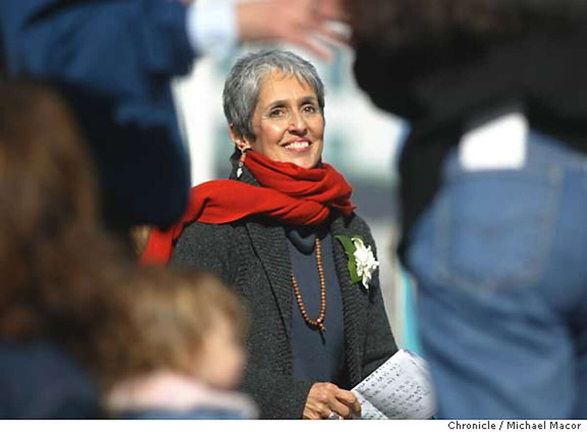 PEACE19L-C-18JAN03-MT-MAC Singer/Musicain and peace activist Joan Baez addresses the crowd at the Civic Center. Anti-war protest fills the streets of San Francisco. by Michael Macor/The Chronicle