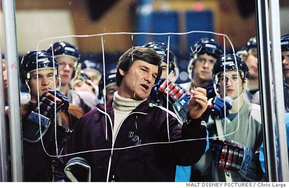 Coach Herb Brooks (Kurt Russell, center) is told that his group of college players dont stand a chance at the 1980 Olympic Games against the juggernaut from the Soviet Union, but the visionary coach leads his underdog team to an improbable victory in Walt Disney Pictures inspirational new film, Miracle. (AP Photo/Chris Large) Kurt Russell (center) is U.S. coach Herb Brooks, who maps out a strategy for his Olympic hockey team in &quo;Miracle.&quo; ProductName	Chronicle ProductName	Chronicle ProductName	Chronicle Photo: CHRIS LARGE