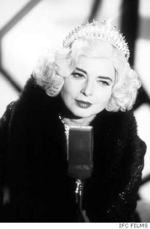 SADDEST21  Isabella Rossellini (Lady Port-Huntly) with microphone in a scene from THE SADDEST MUSIC IN THE WORLD.