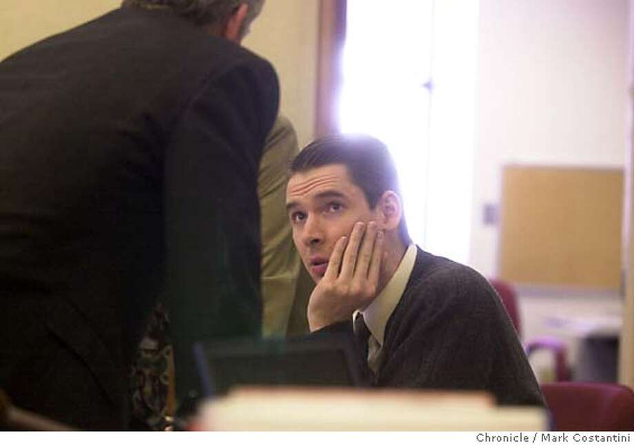 HELZER21_036.JPG Photo taken on 5/21/04 in MARTINEZ.  Helzer confers with one of his lawyers.  The cast of characters in the trial of Justin Helzer, which has already included a Playboy centerfold, expands to include a Wiccan, Debra McClanahan who will take the stand to explain what she taught the Helzer brothers in their scheme to launch a self-help group and prostitution ring serving wealthy men. The scheme led to the extortion and killing of a Concord couple and the deaths of three others who learned of the scheme in 2000. hoto: Mark Costantini/SF Chronicle Photo: MARK COSTANTINI