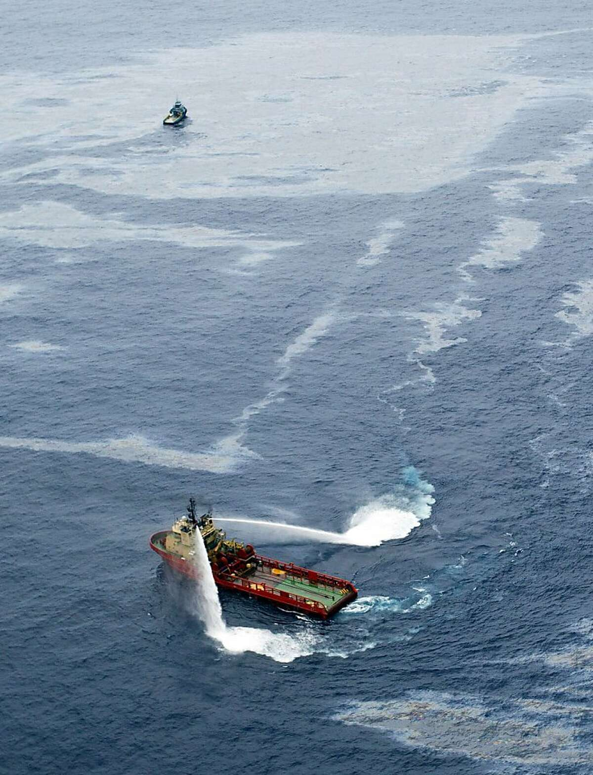 """RESTRICTED TO EDITORIAL USE - MANDATORY CREDIT """"AFP PHOTO/Agncia O GLOBO/Marcia Foletto"""" - NO MARKETING NO ADVERTISING CAMPAIGNS - DISTRIBUTED AS A SERVICE TO CLIENTS - NO ARCHIVES - BRAZIL OUT - INTERNET OUT Handout picture released by Agencia O Globo showing a supply boat working around an oil spill at the Frade field located in the Atlantic Ocean some 370 Km northeast of Rio de Janeiro, on November 18, 2011. The spill, at an offshore well operated by the US energy giant Chevron off the Brazilian coast was detected 10 days ago. On Thursday, Chevron said cementing operations were underway after Brazilian authorities warned that it faces severe punishment if it fails to completely seal the offshore well. AFP PHOTO/Agncia O GLOBO/Marcia Foletto -- BRAZIL OUT - INTERNET OUT (Photo credit should read Marcia Foletto/AFP/Getty Images) Publication: The Houston Chronicle PubDate: 11/19/2011 - PageNo: 3 - Section: D - Edition: H6 - CIMAGEID: 21520767 Caption: AFP / AGENCIA O GLOBO RESTRICTED TO EDITORIAL USE - MANDATORY CREDIT """"AFP PHOTO/Agência O GLOBO/Marcia Foletto"""" - NO MARKETING NO ADVERTISING CAMPAIGNS - DISTRIBUTED AS A SERVICE TO CLIENTS - NO ARCHIVES - BRAZIL OUT - INTERNET OUT Handout picture released by Agencia O Globo showing a supply boat working around an oil spill at the Frade field located in the Atlantic Ocean some 370 Km northeast of Rio de Janeiro, on November 18, 2011. The spill, at an offshore well operated by the US energy giant Chevron off the Brazilian coast was detected 10 days ago. On Thursday, Chevron said cementing operations were underway after Brazilian authorities warned that it faces severe punishment if it fails to completely seal the offshore well. AFP PHOTO/Agência O GLOBO/Marcia Foletto -- BRAZIL OUT - INTERNET OUT (Photo credit should read Marcia Foletto/AFP/Getty Images)"""