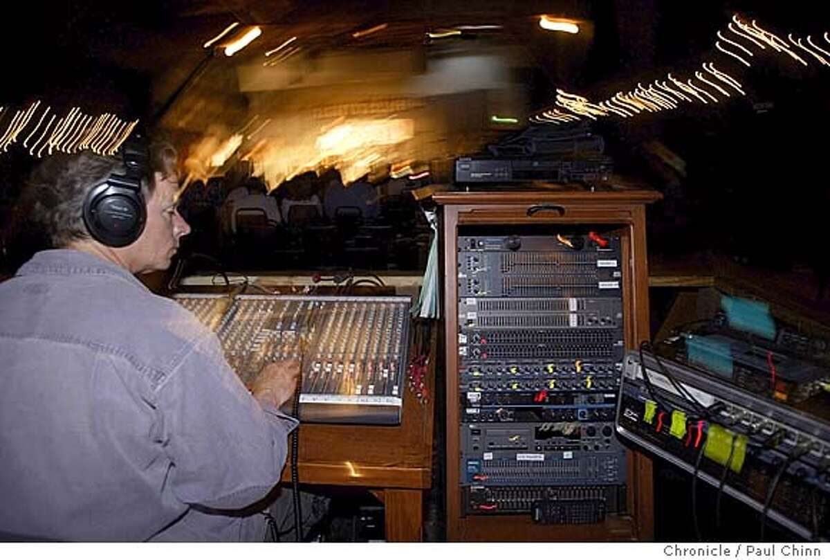 """Radio engineer Mitchell Holman monitors the sound mixing board during the broadcast. The radio program """"West Coast Live"""" broadcast a live program at Freight and Salvage in Berkeley on 5/8/04. PAUL CHINN/The Chronicle"""