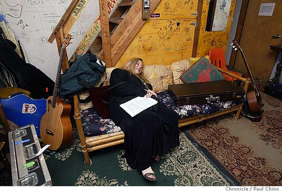 """Pianist Rena Sharon sprawls out on a couch in the Green Room before the broadcast. The radio program """"West Coast Live"""" broadcast a live program at Freight and Salvage in Berkeley on 5/8/04. PAUL CHINN/The Chronicle"""