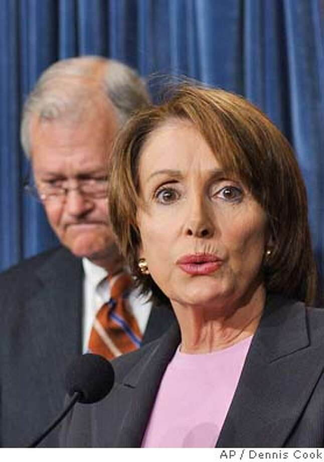 House Minority Leader Nancy Pelosi, D-Calif., calls for Defense Secretary Donald Rumsfeld's resignation on Capitol Hill Thursday, May 6, 2004, following revelations related to the treatment of of Way. At left is Rep. Ike Skelton, D-Mo. (AP Photo/Dennis Cook) Photo: DENNIS COOK