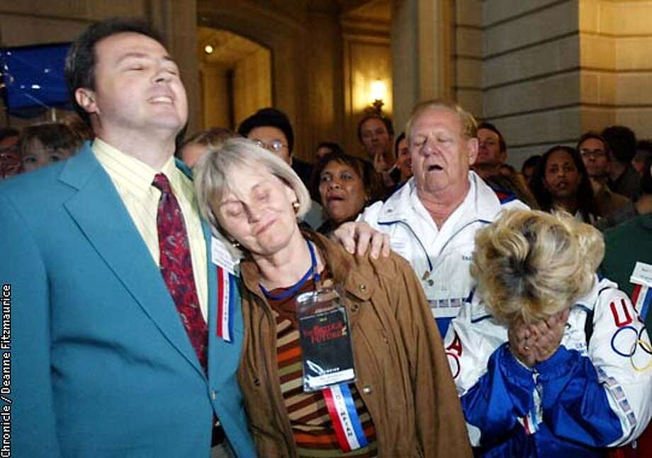 People at City Hall rotunda react to the announcement that San Francisco lost out on the bid for the 2012 Olympics. ( l to r) former Olympians: Greg Massialas, fencing 1980, 1984, 1988; Bev Brockway, 1960 skiing; Jerome Reitenbach, Taekwondo official, and Sydney Reese, also Taekwondo official.  CHRONICLE PHOTO BY DEANNE FITZMAURICE Photo: DEANNE FITZMAURICE