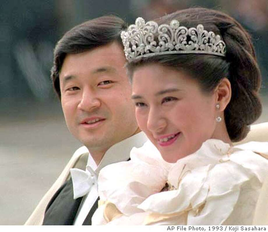**FILE**Newly wed Crown Prince Naruhito and Crown Princess Masako smile at wellwishers as a 29-car motorcade leaves the Imperial Palace for a four-kilometer (2.5-mile) parade to the Togu Palace, their honeymoon home, in Tokyo in this June 9, 1993 file photo. The royal couple were married 11 years ago amid much rejoicing by a public enamored by Masako's cordial style and impeccable upbringing _ the daughter of one of Japan's most respected diplomats, she was educated at Harvard and Oxford and was seen as a rising star in the foreign service. But instead of blossoming as a royal ambassador, she has been a virtual prisoner of the palace _ an issue the 44-year-old prince raised repeatedly at his press conference prior to his departure to Europe Wednesday, May 12, 2004. (AP Photo/Koji Sasahara, FILE) A JUNE 9, 1993 FILE PHOTO FOR ERIC TALMADGE STORY Photo: KOJI SASAHARA