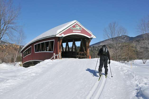 The nonprofit Jackson Ski Touring Center is considered the best spot for cross-country skiing in the East. A red covered bridge greets skiers at the outset of the center's picturesque Ellis River Trail. Photo: Margo Pfeiff, Special To The Chronicle