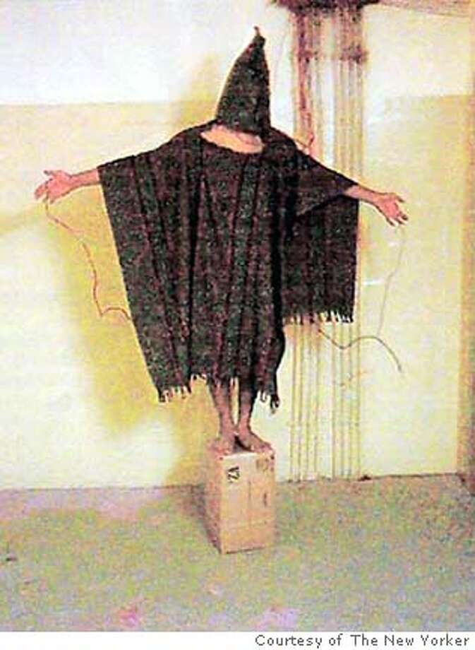 A hooded and wired Iraqi prisoner is seen at the Abu Ghraib prison near Baghdad, Iraq in this undated photo. (AP Photo/Courtesy of The New Yorker) ** ** MANDATORY CREDIT ** A hooded Iraqi was rigged to wires by U.S. forces at Abu Ghraib prison near Baghdad.
