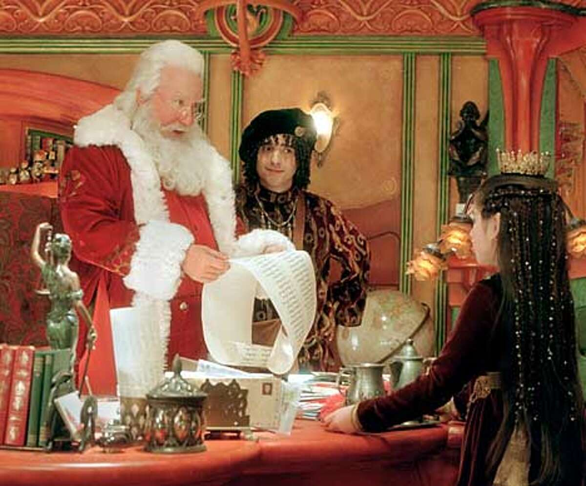 When naughty-or-nice elf Abby (Danielle Woodman, right) and Head Elf Bernard (David Krumholtz, center) show Santa (Tim Allen, left) that his son, Charlie, is on the naughty list, the big guy is stunned. Disney�s �The Santa Clause 2� is directed by Michael Lembeck from a screenplay by Don Rhymer and Cinco Paul & Ken Daurio and Ed Decter & John Strauss, a story by Leo Benvenuti & Steve Rudnick, based on characters created by Leo Benvenuti & Steve Rudnick. Executive Producers are William W. Wilson III, Rick Messina, Richard Baker, and James Miller. The film is produced by Brian Reilly, Bobby Newmyer, and Jeffrey Silver. The film is distributed by Buena Vista Pictures Distribution. Photo Credit: Joseph Lederer. Permission is hereby granted to newspapers and magazines to reproduce this picture on the condition that it is used in connection with direct publicity for the movie in which it appears and that it is accompanied by ҩDisney Enterprises, Inc. All Rights Reserved.� All other uses require prior written consent of Walt Disney Pictures.
