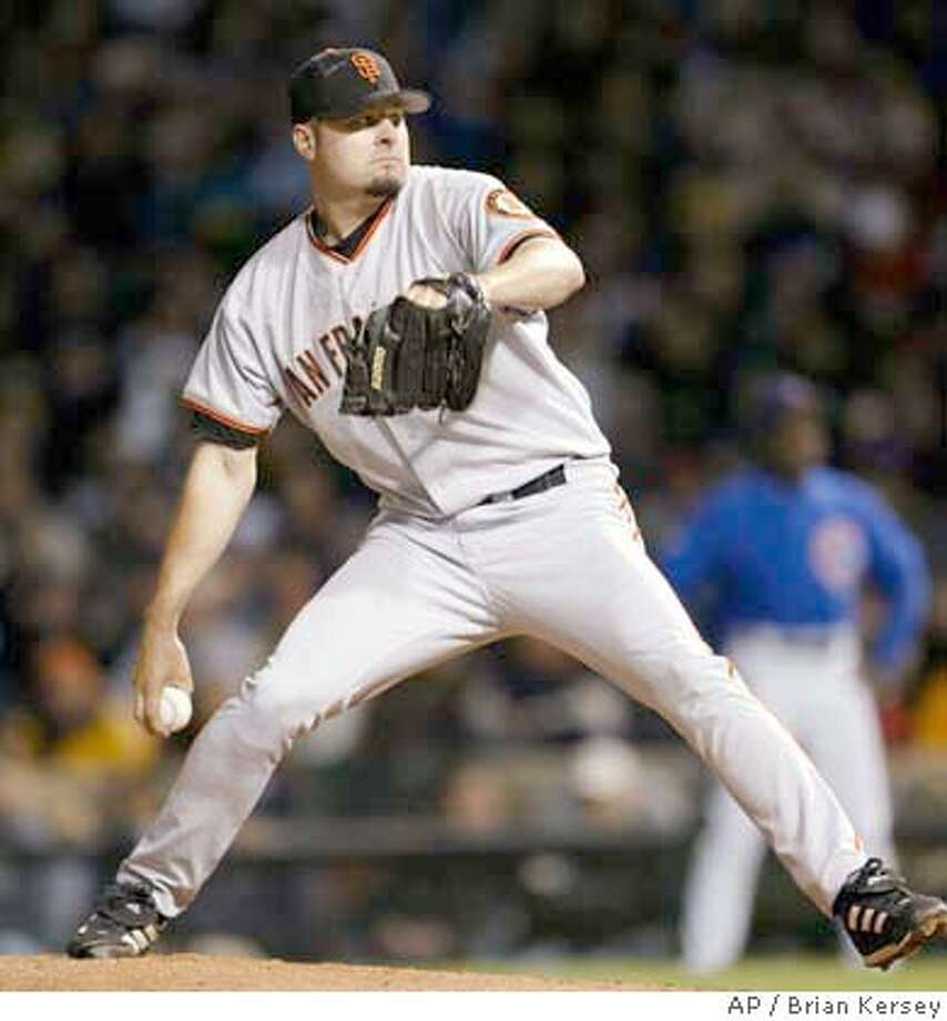 San Francisco Giants' pitcher Jason Schmidt delivers a pitch during the fourth inning against the Chicago Cubs, Tuesday, May 18, 2004, in Chicago. (AP Photo/Brian Kersey) Photo: BRIAN KERSEY