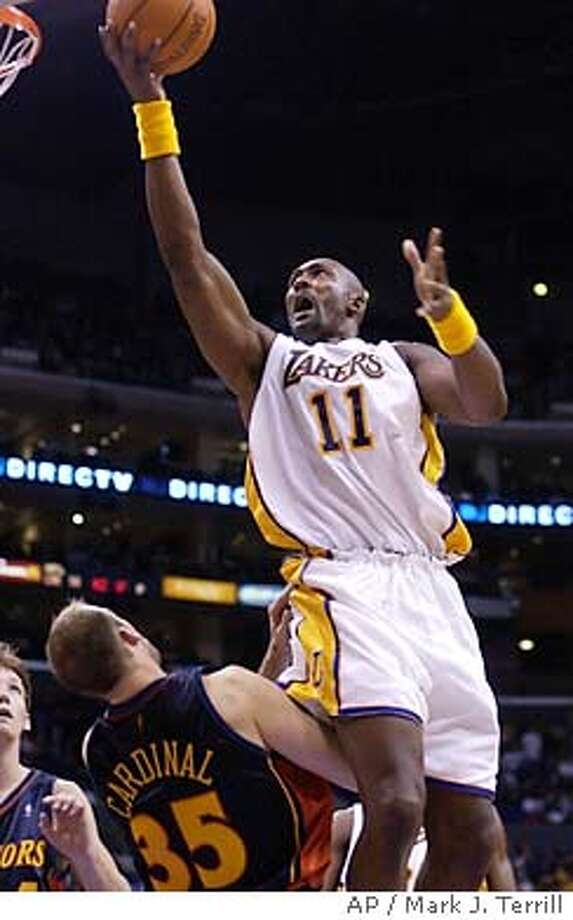 Los Angeles Lakers' Karl Malone shoots over Golden State Warriors' Brian Cardinal during the second half, Sunday, Nov. 2, 2003, in Los Angeles. (AP Photo/Mark J. Terrill) Photo: MARK J. TERRILL