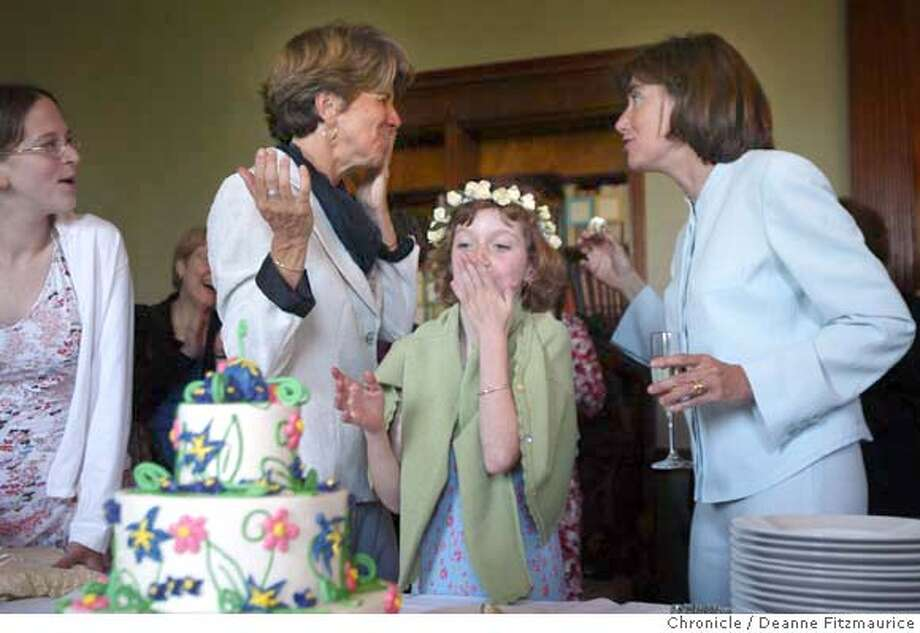 Hillary (left) laughs as she is fed wedding cake by her new spouse Julie (at right). In the middle is daughter, Annie, 8, who was the flower girl and ring bearer.  Hillary Goodridge (short blond hair) and Julie Goodridge, lead plantiffs in the landmark case Goodridge vs the Massachusetts Department of Health to allow same-sex marriages in Massachusetts. This is the first time in U.S. History a state, Massachusetts, began granting marriage licenses to same-sex couples with approval of the highest court.  Deanne Fitzmaurice /The Chronicle Photo: Deanne Fitzmaurice