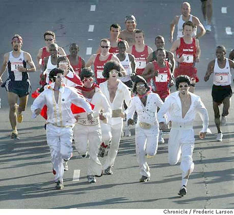 ; : At the annual SF Bay to Breakers Race a group of Elvises crash the elite runners on the course at Howard near 4th Street but tired out quickly. Benjamin Maiyo placed first overall in this year's annual Bay to Breakers race in San Francisco on Sunday. At the finish line at Ocean Beach says this is the 13th year in a row that a Kenyan runner has won the race. This is Maiyo's first win. Fellow Kenyan James Koskei had won the previous three years. Others not so serious about placing where thousands of party revelers from Elvises to naked George Bushes, Wonder Women and many beer wagons in tow. Despite warnings from the organizers that police might issue citations for public nudity, the clothes still came off for many runners. Seventeen year-old Adam Bates was the first naked finisher overall. 5/16/04  San Francisco Chronicle Frederic Larson Photo: Frederic Larson