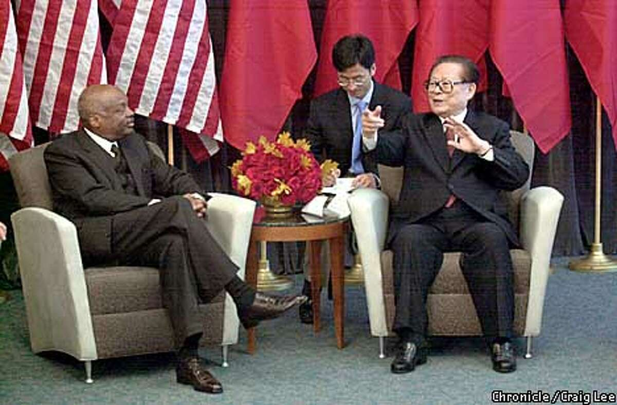 With a translater behind him China's President Jiang Zemin (right) talks with San Francisco Mayor Willie. China's President, Jiang Zemin, arrives at San Francisco International Airport monday Oct 29th concluding his visit to the United States.By Craig Lee/San Francisco Chronicle
