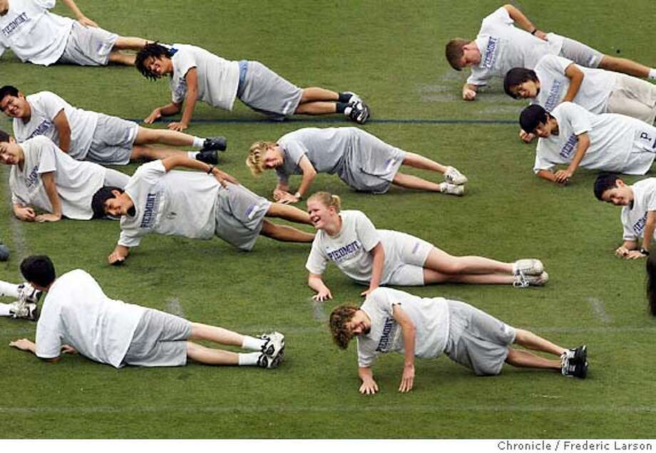 ; Piedmont High School P.E class does organized work-outs on the football field. Brown v. Board of education 50th anniversary story comparing Piedmont High, a nearly all white school (with Asian Americans as the next largest group.) to West Oakland McClymonds H.S where the student body is nearly all African American. 5/7/04  San Francisco Chronicle Frederic Larson Photo: Frederic Larson