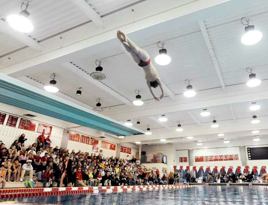 Greenwich High School diver Jeff Aselin soars above the GHS pool during the diving competition in the boys high school swim meet between Fairfield Prep and Greenwich High School at Greenwich, Saturday, Jan. 28, 2011. Photo: Bob Luckey / Greenwich Time