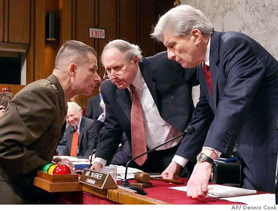 Deputy Joint Chiefs of Staff Vice Chairman Gen. Peter Pace talks to Senate Armed Services Committee Chairman John Warner, R-Va., right, and Sen. Carl Levin, D-Mich, center, on Capitol Hill Thursday, May 13, 2004, prior to a hearing on the Pentagon's contingency reserve fund for the war in Iraq. (AP Photo/Dennis Cook) Photo: DENNIS COOK