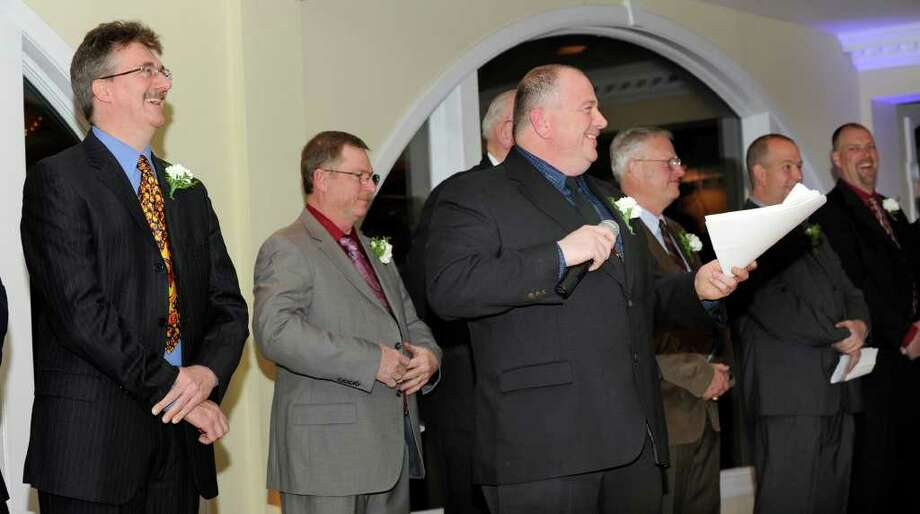 Chief Jeff Emmons, center, with fellow officers of the Water Witch Hose Co. No. 2, share a laugh during his speech at the company dinner-dance held at the Candlewood Inn Friday, January 20, 2012. Photo: Carol Kaliff / The News-Times
