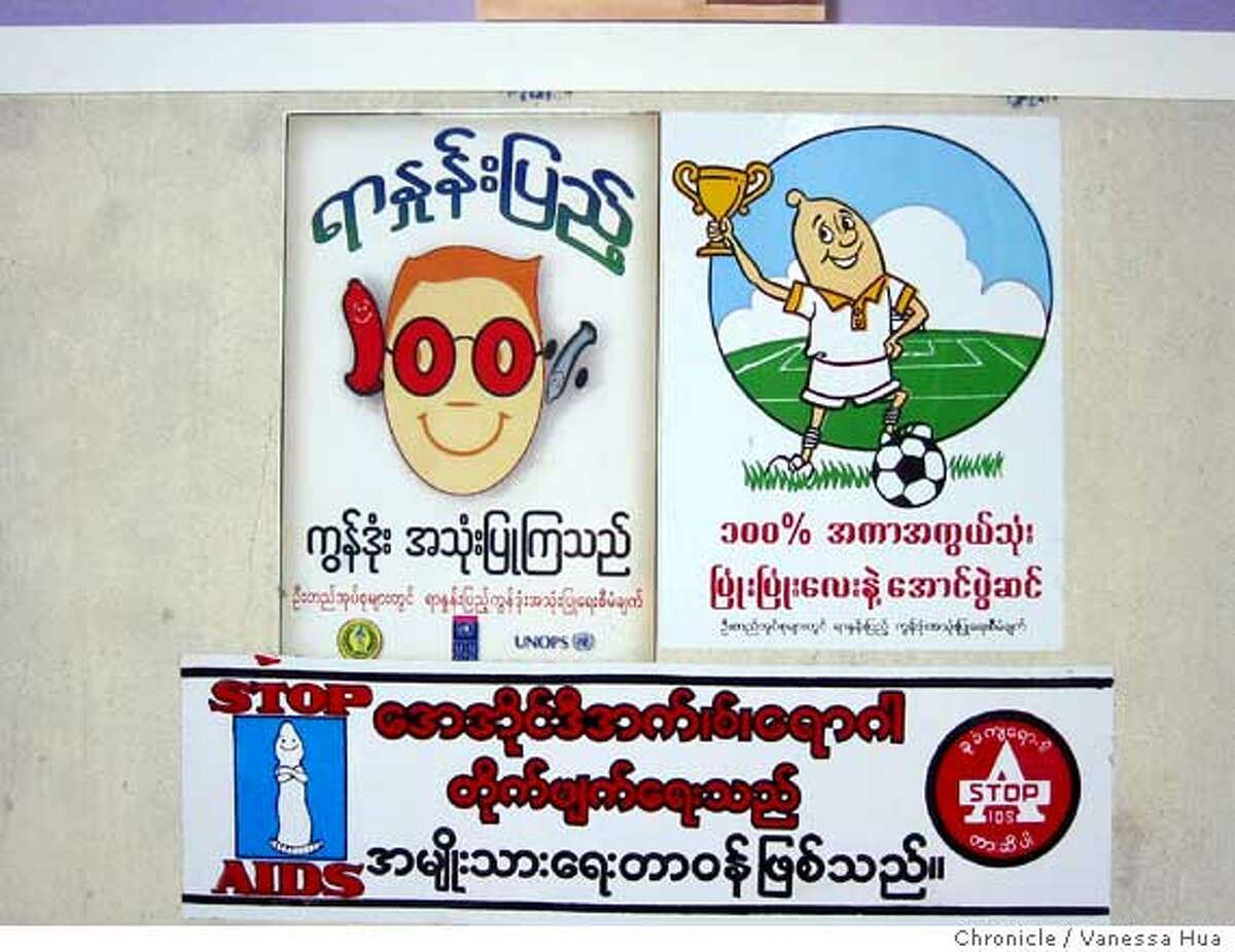 Posters at a health clinic in Pathein, Burma, promote condom use. Poor health care and striking ignorance about reproduction have contributed to a huge rate of HIV infection in the country. One study said almost 3.5 percent of the country is infected. Chronicle photo by Vanessa Hua