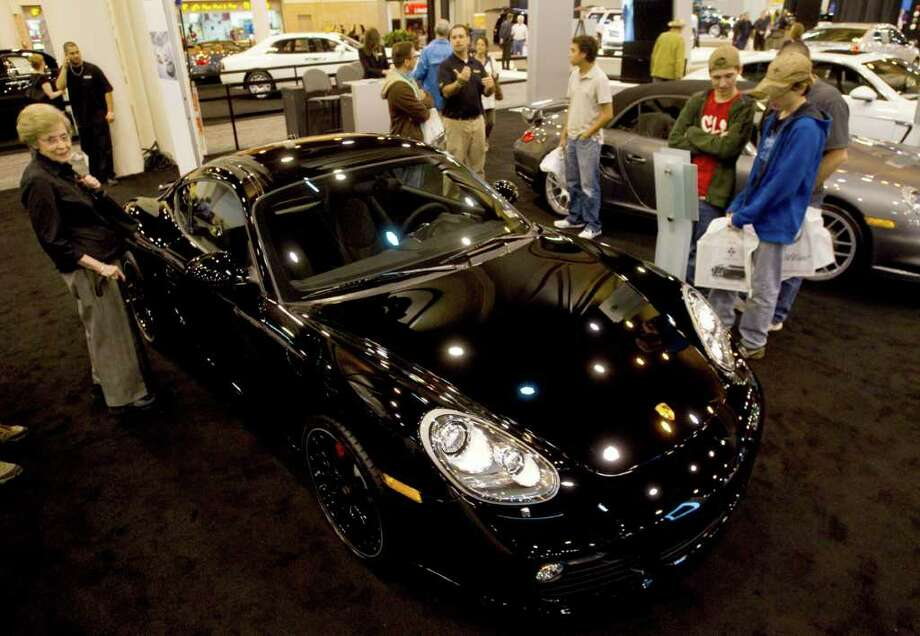 Patrons at the Houston Auto Show check out a Porsche Wednesday, Jan. 25, 2012, in Houston. Photo: Brett Coomer, Houston Chronicle / © 2012 Houston Chronicle