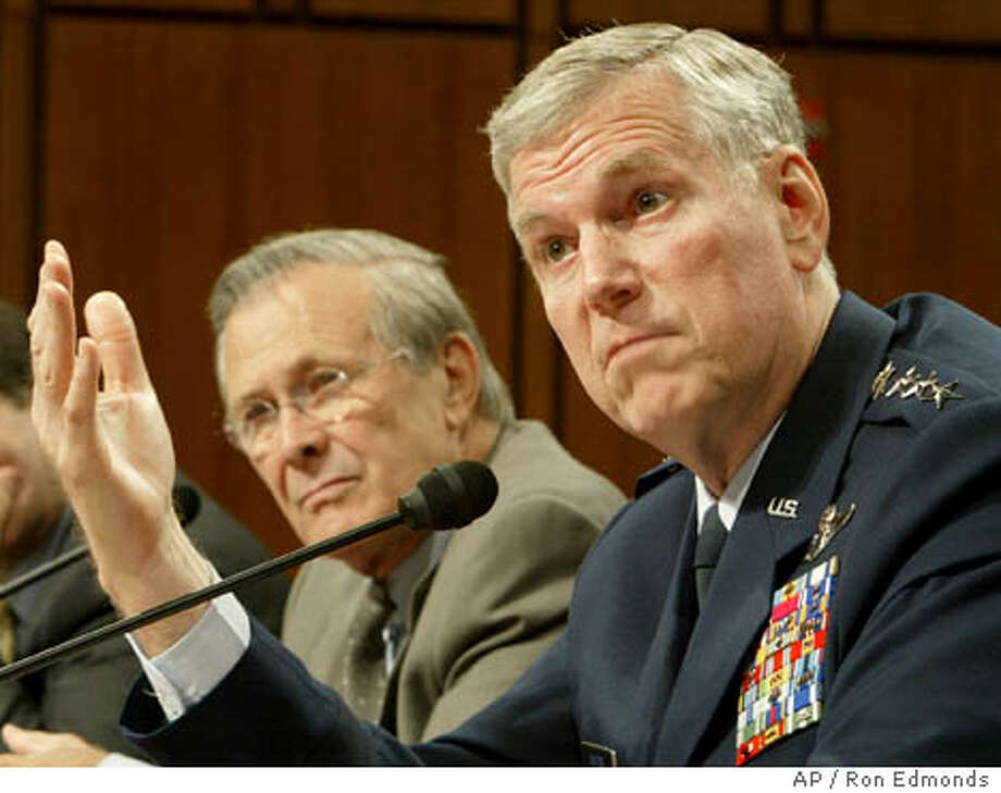 Secretary of Defense Donald H. Rumsfeld, left, and Joint Chiefs of Staff Chairman Richard Myers, right, testify, Wednesday, May 12, 2004, before the Senate Defense Appropriations committee in Washington. (AP Photo/ Ron Edmonds) Photo: RON EDMONDS