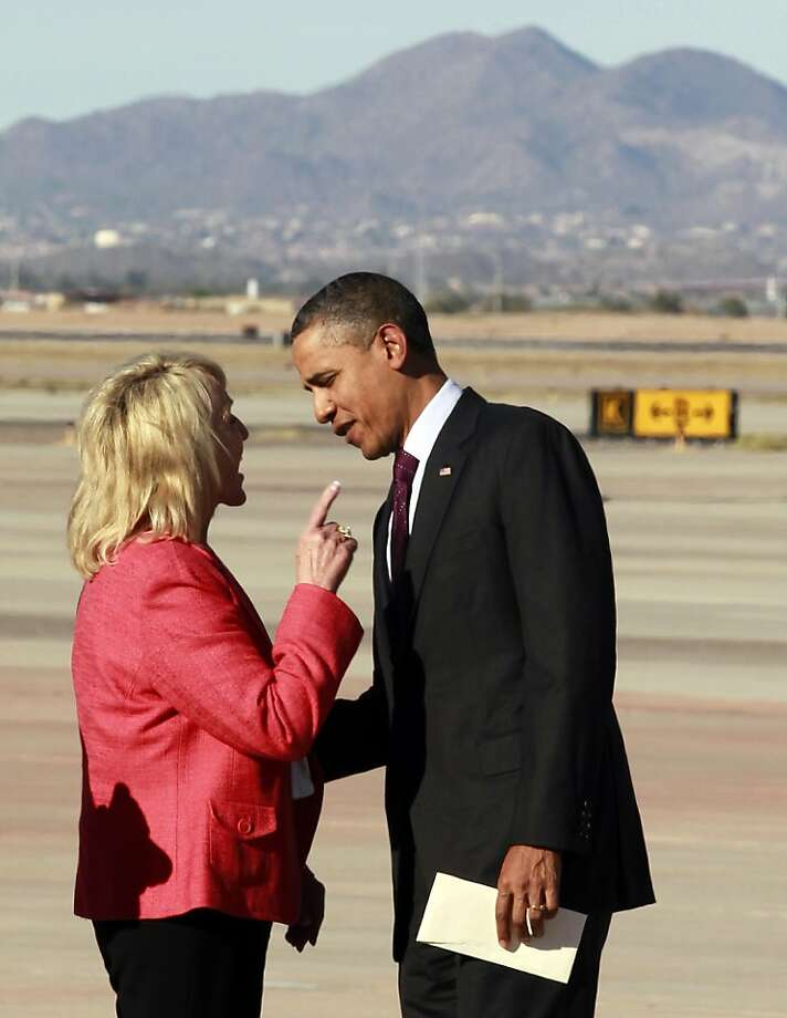 "Arizona Gov. Jan Brewer points at President Barack Obama after he arrived at Phoenix-Mesa Gateway Airport, Wednesday, Jan. 25, 2012, in Mesa, Ariz. Brewer greeted Obama and what she got was a book critique. Of her book. The two leaders engaged in an intense conversation at the base of Air Force One's steps. Both could be seen smiling, but speaking at the same time. Asked moments later what the conversation was about, Brewer, a Republican, said: ""He was a little disturbed about my book."" Brewer recently published a book, ""Scorpions for Breakfast,"" something of a memoir that describes her years growing up and defends her signing of Arizona's controversial law cracking down on illegal immigrants, which Obama opposes. Brewer also handed Obama an envelope with a handwritten invitation for Obama to return to Arizona to meet her for lunch and to join her for a visit to the border.  (AP Photo/Haraz N. Ghanbari) Photo: Haraz N. Ghanbari, Associated Press"