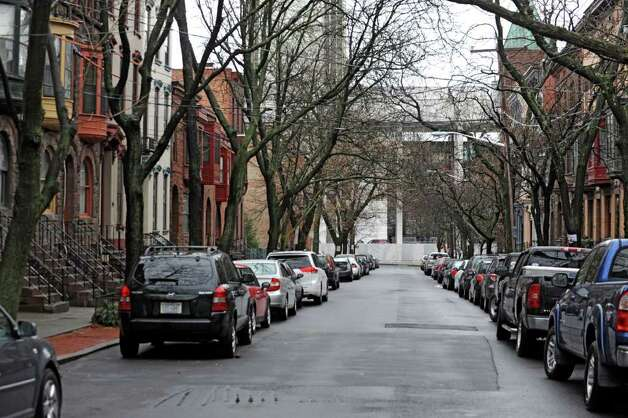 An empty parking spot is a rare site on Lancaster St. during Friday Jan. 27, 2012 in Albany, N.Y.  Albany's Common Council is ready to schedule a vote on the creation of the long-desired parking permit system. (Lori Van Buren / Times Union) Photo: Lori Van Buren