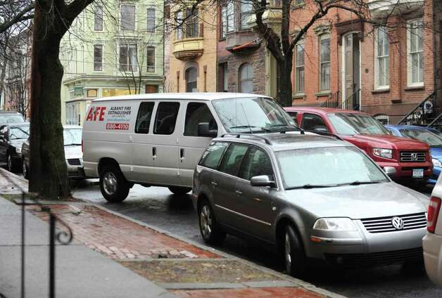 A van parks along Lancaster St. Friday Jan. 27, 2012 in Albany, N.Y.  Albany's Common Council is ready to schedule a vote on the creation of the long-desired parking permit system. (Lori Van Buren / Times Union) Photo: Lori Van Buren