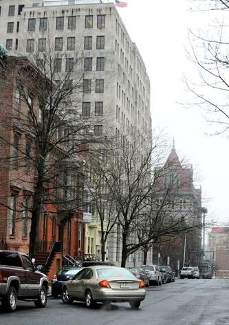 A car goes to park along State St. Friday Jan. 27, 2012 in Albany, N.Y.  Albany's Common Council is ready to schedule a vote on the creation of the long-desired parking permit system. (Lori Van Buren / Times Union) Photo: Lori Van Buren