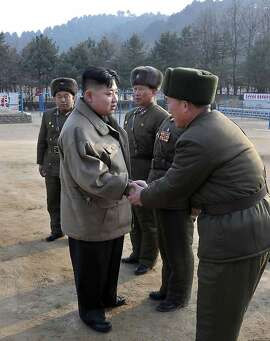 "---EDITORS NOTE--- RESTRICTED TO EDITORIAL USE - MANDATORY CREDIT ""AFP PHOTO / KCNA VIA KNS"" - NO MARKETING NO ADVERTISING CAMPAIGNS - DISTRIBUTED AS A SERVICE TO CLIENTS This undated picture, released by North Korea's official Korean Central News Agency on January 19, 2012 shows new North Korean leader Kim Jong Un (2nd L) inspecting the Korean People's Army Unit 169 honored with the title of the O Jung Hup-led Seventh Regiment at an undisclosed location in North Korea.   AFP PHOTO / KCNA via KNS (Photo credit should read HO/AFP/Getty Images)"