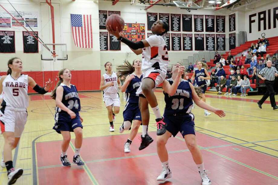 Warde's Tiara Fountain goes up for two as Fairfield Warde High School hosts Staples High School in varsity girls basketball in Fairfield, CT on Friday, Jan. 27, 2012. Photo: Shelley Cryan / Shelley Cryan freelance; freelance for the Connecticut Post