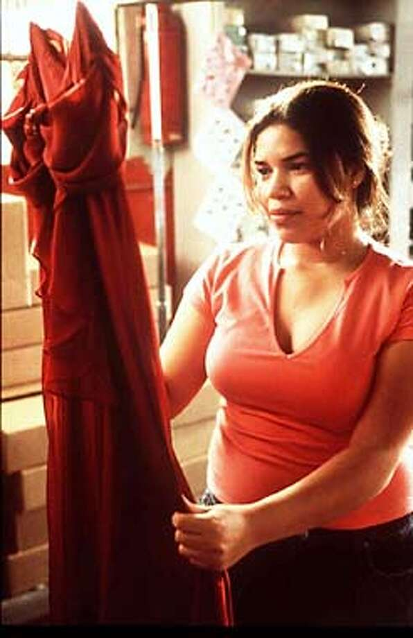 "Ana (America Ferrera) a plus sized Mexican-American teenager, finds herself struggling to break free of the responsibilities and expectations of her mother and sister in HBO's drama, ""Real Women Have Curves."" (AP Photo/Nicola Goode/HBO) Photo: NICOLA GOODE"