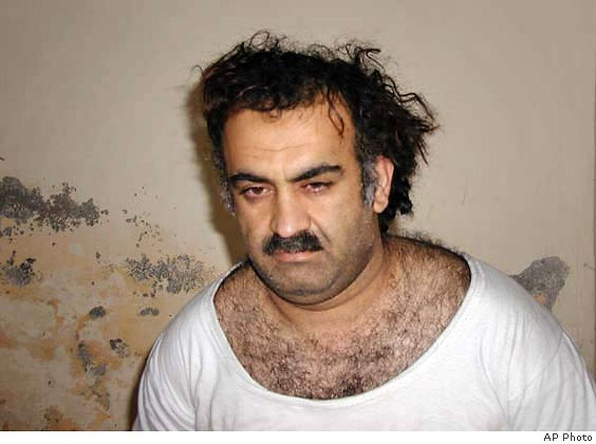 ** FILE ** Khalid Shaikh Mohammed, the alleged Sept. 11 mastermind, is seen shortly after his capture during a raid in Pakistan Saturday March 1, 2003 in this photo obtained by the Associated Press. American authorities investigating the killing of Wall Street Journal reporter Daniel Pearl in Pakistan now believe that he was slain by the hand of Mohammed. The U.S. acknowledgment of Mohammeds suspected role was first reported in the Wall Street Journal Tuesday, Oct. 21, 2003. (AP Photo) Daniel Pearl, left, was slain by Khalid Shaikh Mohammed, right, U.S. officials say. Photo caption pearl22_PH21046390400** FILE ** Khalid Shaikh Mohammed, the alleged Sept. 11 mastermind, is seen shortly after his capture during a raid in Pakistan Saturday March 1, 2003 in this photo obtained by the Associated Press. American authorities investigating the killing of Wall Street Journal reporter Daniel Pearl in Pakistan now believe that he was slain by the hand of Mohammed. The U.S. acknowledgment of Mohammeds suspected role was first reported in the Wall Street Journal Tuesday, Oct. 21, 2003. (AP Photo) cat